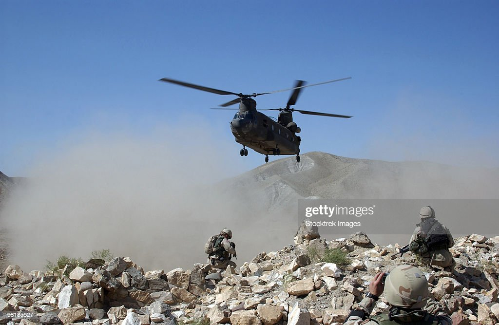 Clouds of dust kicked up by the rotor wash of a CH-47 Chinook helicopter in Afghanistan. : Stock Photo