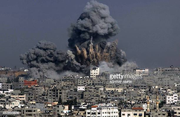 Clouds of heavy smoke billow into the air following an Israeli military strike in Gaza City on July 29 2014 The Israeli offensive which began on July...
