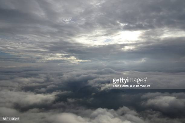 Clouds on Islands in Seto Inland Sea in Ehime prefecture daytime aerial view from airplane