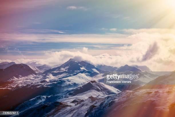 Clouds on snow capped mountain peaks, Lenzerheide, Swiss Alps, Switzerland