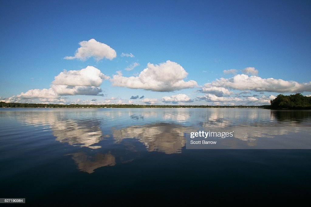 Clouds over a lake : Stockfoto