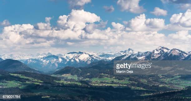 clouds over alps - vorarlberg stock-fotos und bilder