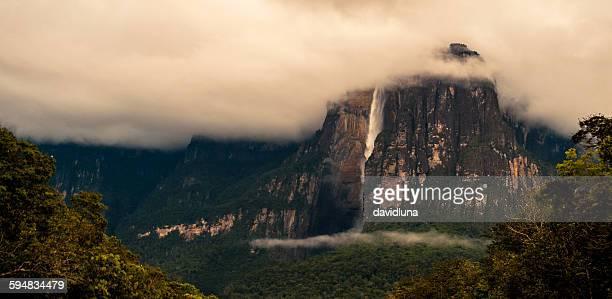 clouds over angel falls, canaima national park, gran sabana,  venezuela - angel falls stock photos and pictures
