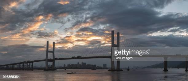 Clouds over bridge at sunset, Wenzhou, Zhejiang, China