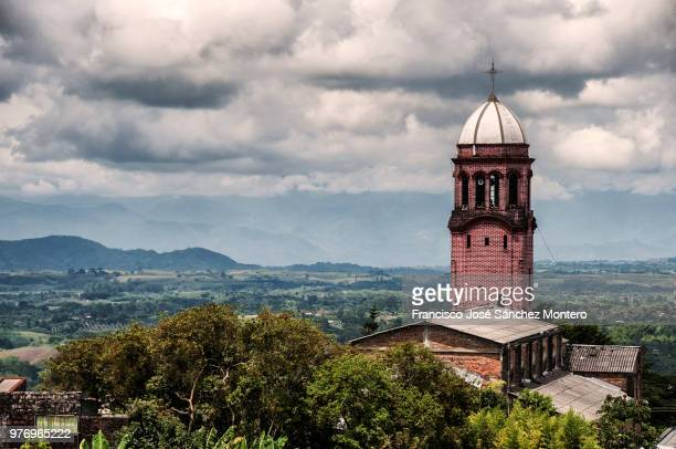 clouds over church in ulloa, valle del cauca, colombia - valle del cauca stock pictures, royalty-free photos & images