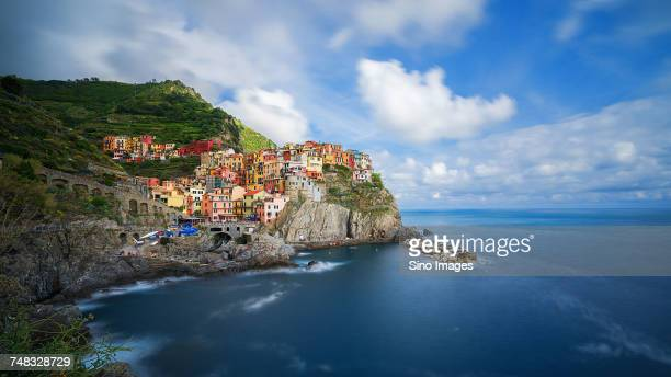 clouds over cliffside town, italy - image foto e immagini stock
