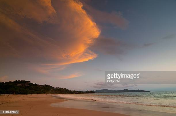 clouds over costa rican beach at sunset - ogphoto stock photos and pictures