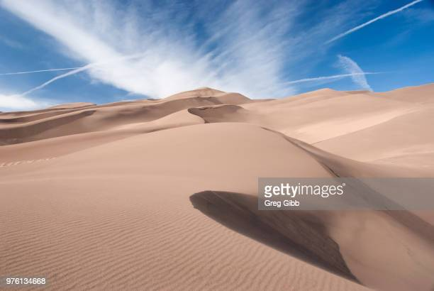 clouds over desert, colorado, usa - great sand dunes national park stock pictures, royalty-free photos & images