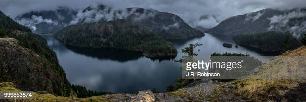 clouds over diablo lake - diablo lake stock photos and pictures
