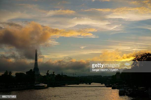 Clouds Over Eiffel Tower And Seine River In Paris