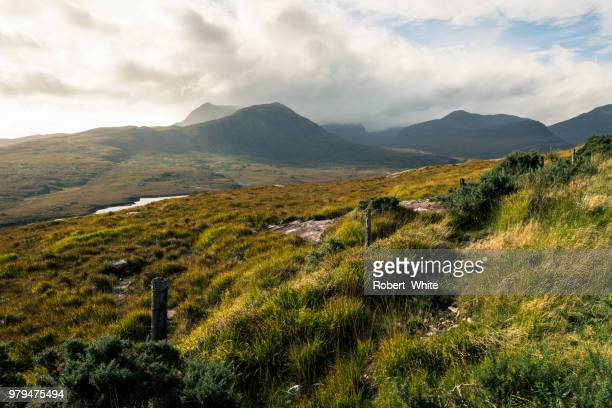 Clouds over grassy mountains, Ullapool, Scotland, UK
