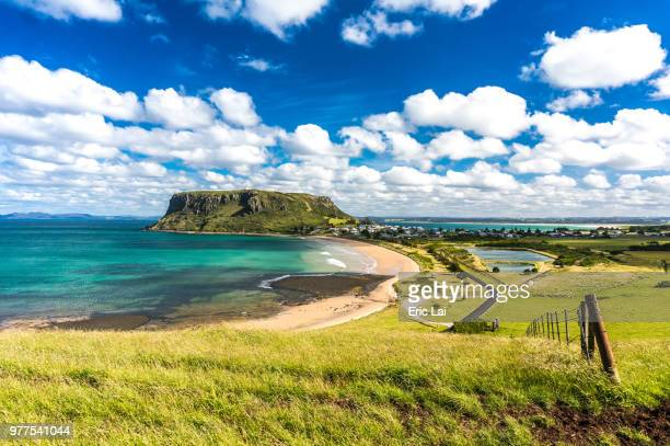 clouds over green coastline, stanley, tasmania - tasmania stock pictures, royalty-free photos & images
