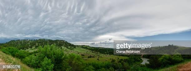 clouds over green landscape, valentine, nebraska - nebraska stock pictures, royalty-free photos & images