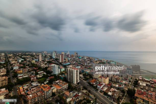 clouds over havana cityscape and ocean, havana, cuba -  565888975 stock pictures, royalty-free photos & images