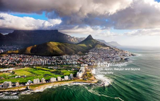 clouds over lion's head and table mountain from helicopter - republik südafrika stock-fotos und bilder