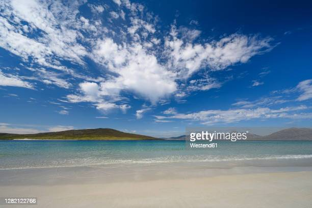 clouds over luskentyre beach in summer - beach stock pictures, royalty-free photos & images