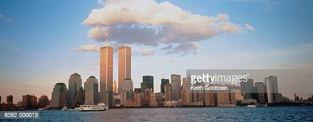 clouds over manhattan skyline - twin towers manhattan stock photos and pictures