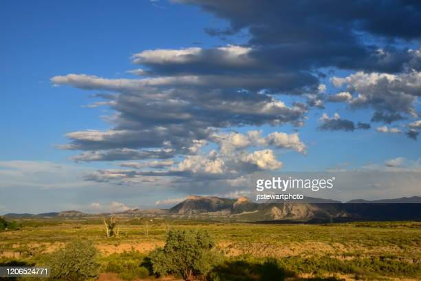 clouds over mesa verde np - pueblo colorado stock pictures, royalty-free photos & images
