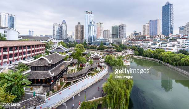 clouds over modern cityscape - guiyang stock pictures, royalty-free photos & images