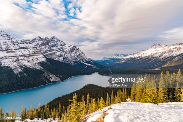 clouds over mountains and river, canada - image stock pictures, royalty-free photos & images