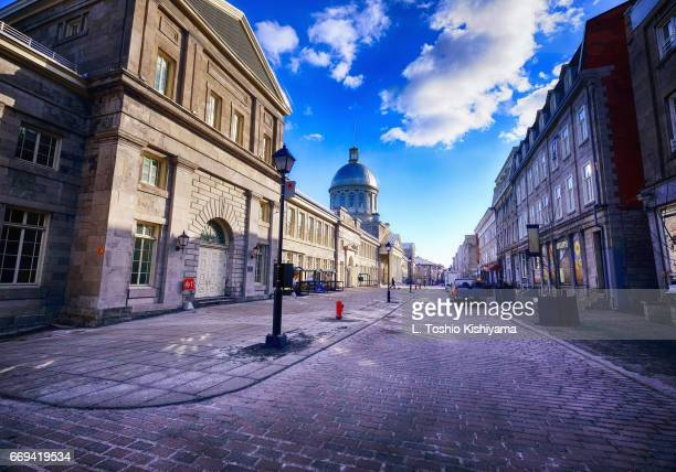 clouds over old town montreal, canada - vieux montréal stock pictures, royalty-free photos & images