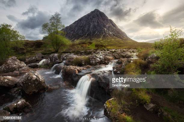 clouds over river and mountain, england, uk - image stock pictures, royalty-free photos & images