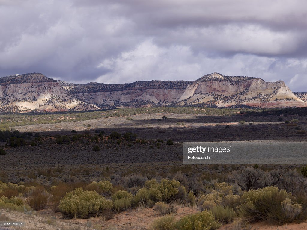 Clouds over rocks : Stock Photo