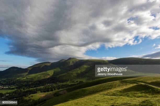 Clouds over rolling landscape