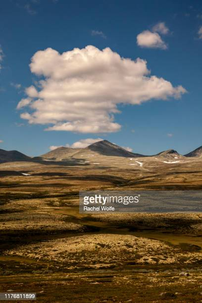 clouds over rondane - rachel wolfe stock photos and pictures