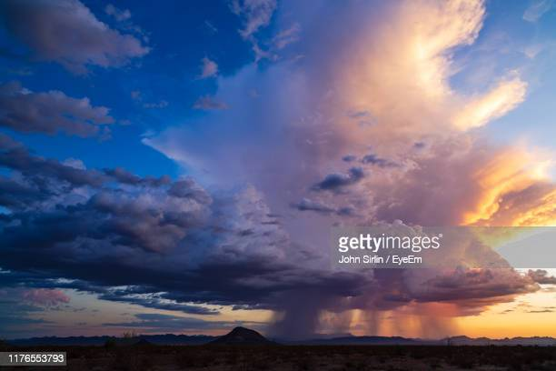 clouds over sea against sky - rainy season stock pictures, royalty-free photos & images