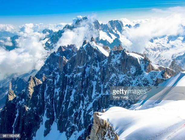 clouds over snowy alps, france - monte bianco foto e immagini stock