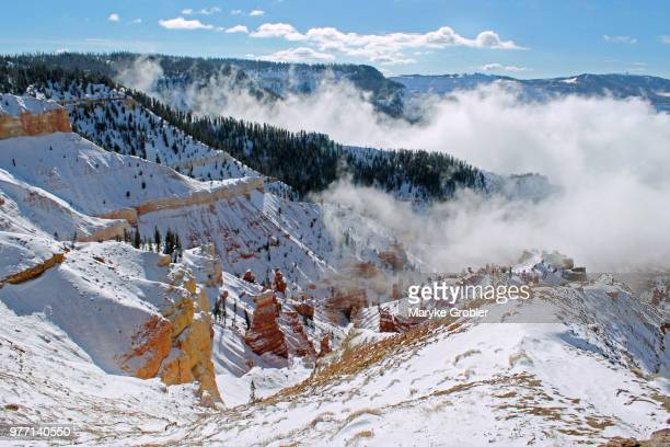 clouds over snowy mountains, brian head, utah, usa - iron_county,_wisconsin stock pictures, royalty-free photos & images