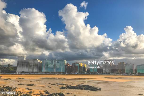 Clouds over the city from the beach