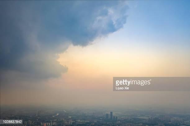 clouds over the city - liyao xie stock-fotos und bilder
