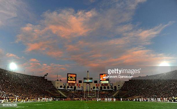Clouds over the Los Angeles Memorial Coliseum turn pink in color as the sun sets during the Oregon State Beavers and USC Trojans college football...