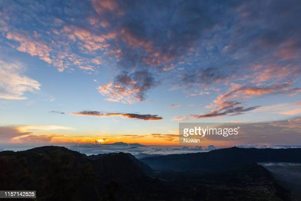 clouds over the mountains in bromo tengger semeru national park - tengger stock pictures, royalty-free photos & images