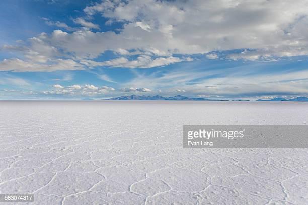 clouds over the salar de uyuni, bolivia - ウユニ ストックフォトと画像