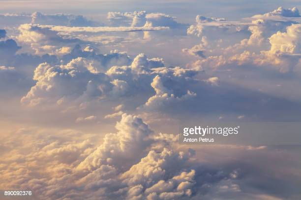 clouds over the sea. view from the airplane window - anton petrus panorama of beautiful sunrise stock pictures, royalty-free photos & images