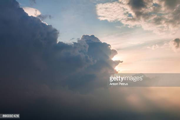 clouds over the sea. view from the airplane window - moody sky stock pictures, royalty-free photos & images