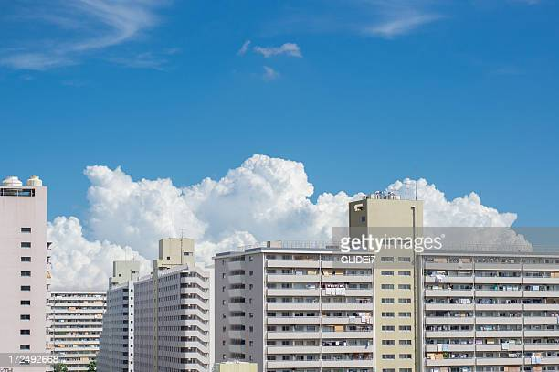 clouds over the skyline - マンション ストックフォトと画像
