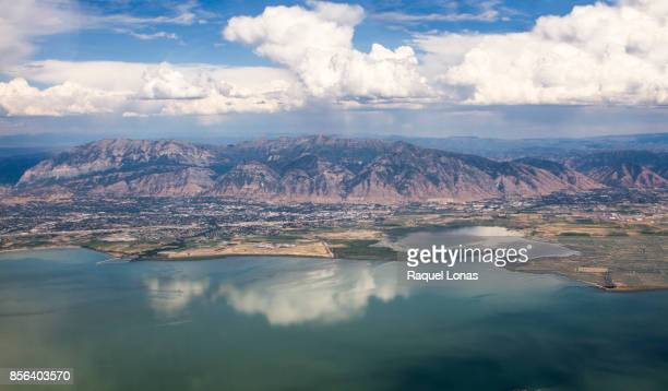 clouds over the wasatch mountains of northern utah from the air - orem utah stock pictures, royalty-free photos & images
