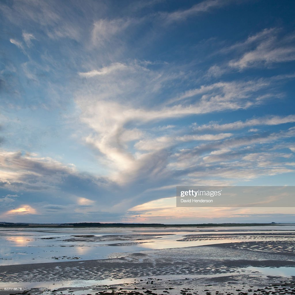 Clouds over tidal pools : Foto stock