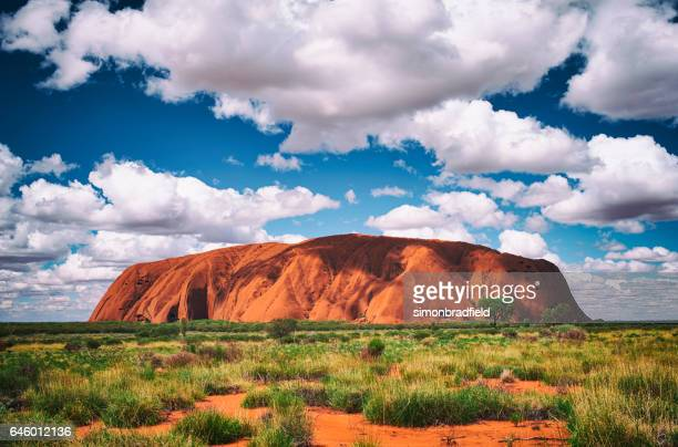 clouds over uluru - uluru stock pictures, royalty-free photos & images