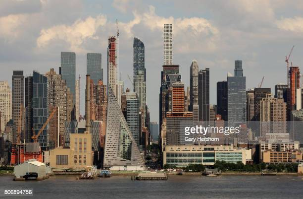 Clouds pass over West 57th Street in New York City on June 25 as seen from Union City NJ
