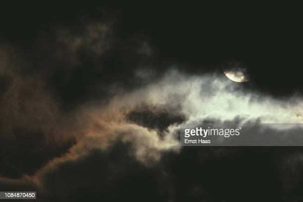 Clouds passing in front of a full moon at night, Florida, USA, 1984.