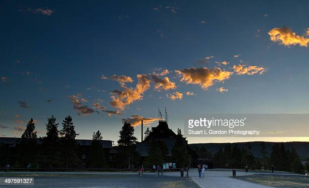 Clouds reflect sunset light above the Old Faithful Inn, Yellowstone National Park, Wyoming.