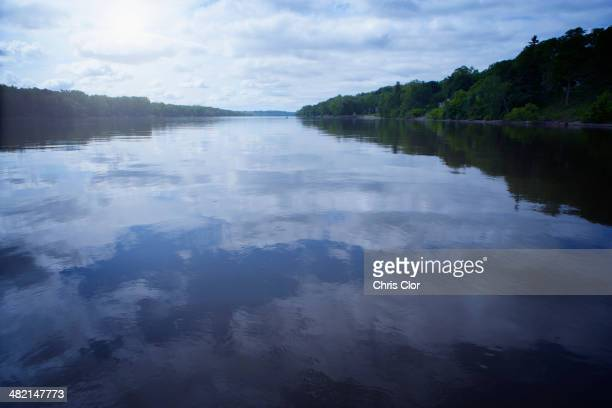 Clouds reflected in still lake, Albany, New York, United States