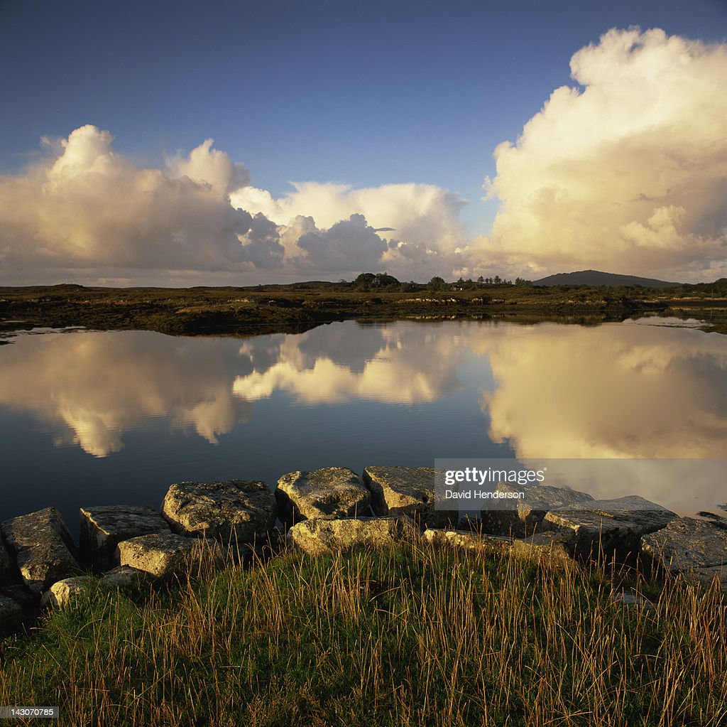 Clouds reflected in still lake : Stock Photo