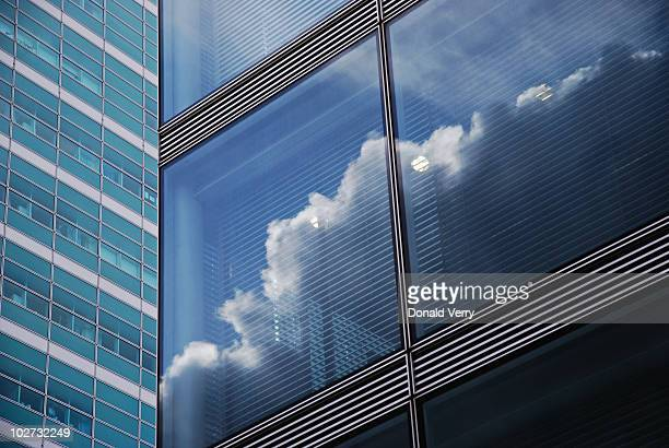clouds reflected in window - skyscraper stock pictures, royalty-free photos & images