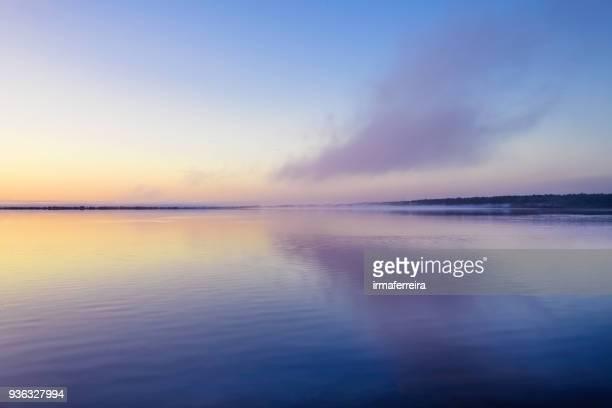 clouds reflecting in a lake, mandurah, western australia, australia - western australia stock pictures, royalty-free photos & images